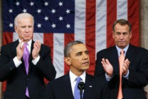 U.S. House Speaker Boehner and Vice President Biden stand to applaud as President Obama delivers his State of the Union speech on Capitol Hill in Washington